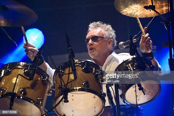 ARENA Photo of QUEEN and Roger TAYLOR Drummer Roger Taylor performing on stage