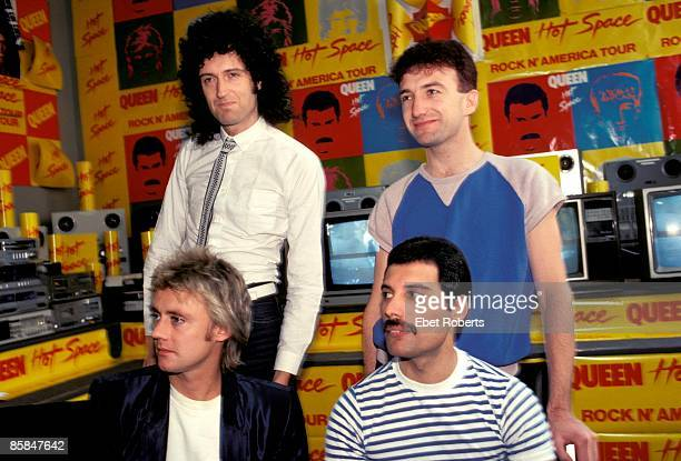 Photo of QUEEN; Back, Brian May and John Deacon, Front, Roger Taylor and Freddie Mercury, posed group portrait