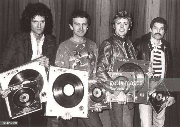 Photo of QUEEN Collecting gold discs for Crazy Little Thing Called Love L to R Brian May John Deacon Roger Taylor Freddie Mercury