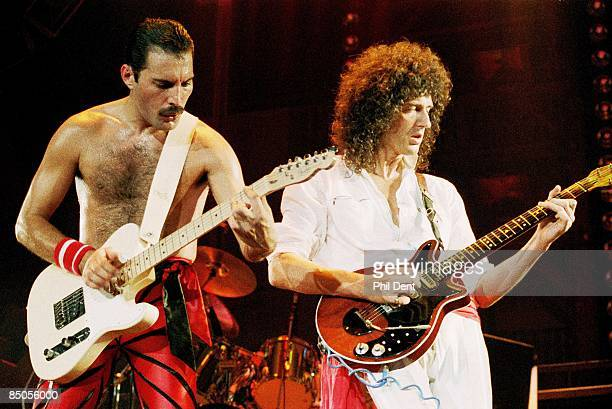 ARENA Photo of QUEEN Freddie Mercury and Brian May performing on stage