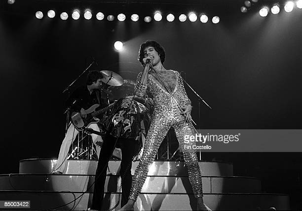 AHOY Photo of QUEEN John Deacon and Freddie Mercury performing on stage