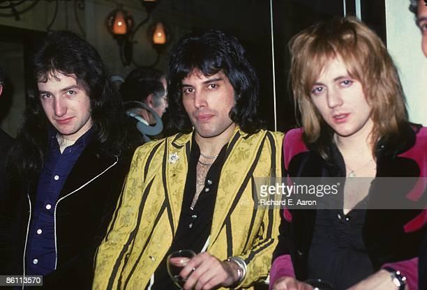 Photo of QUEEN John Deacon Freddie Mercury Roger Taylor posed