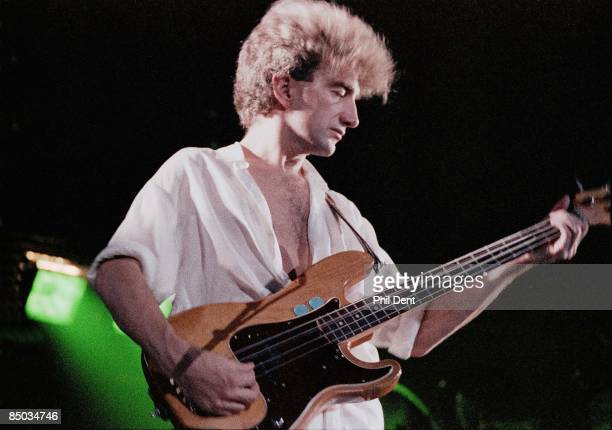 Photo of QUEEN, John Deacon performing on stage