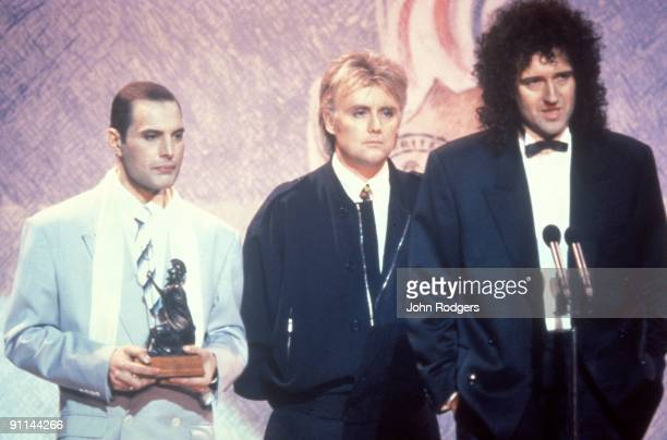 Photo of QUEEN, L- R Freddie Mercury, Roger Taylor and Brian May on stage at the Brit Awards