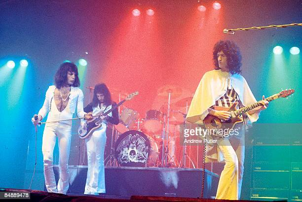 Photo of QUEEN LR Freddie Mercury John Deacon and Brian May performing live on stage