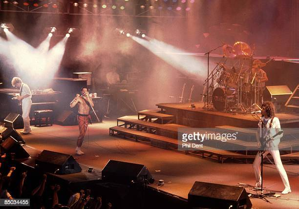 John Deacon Freddie Mercury Roger Taylor Brian May performing live on stage