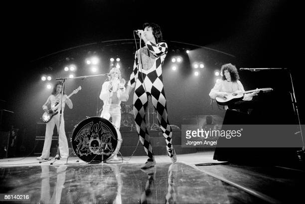 Photo of QUEEN LR John Deacon Roger Taylor Freddie Mercury and Brian May performing on stage at Broendby Hall