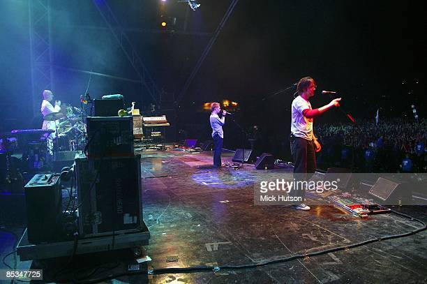 FESTIVAL Photo of RADIOHEAD Phil Selway Thom Yorke Ed O'Brien performing live onstage view from stage looking out over audience