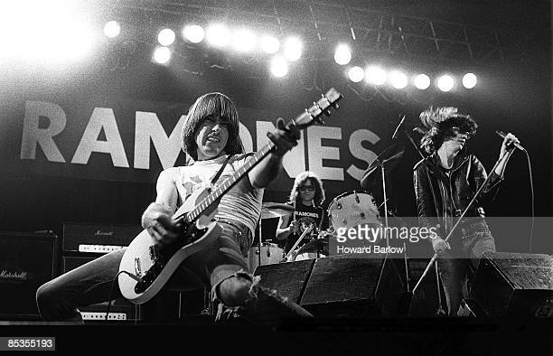 APOLLO Photo of RAMONES and Johnny RAMONE and Joey RAMONE and Tommy RAMONE LR Johnny Tommy and Joey Ramone performing on stage
