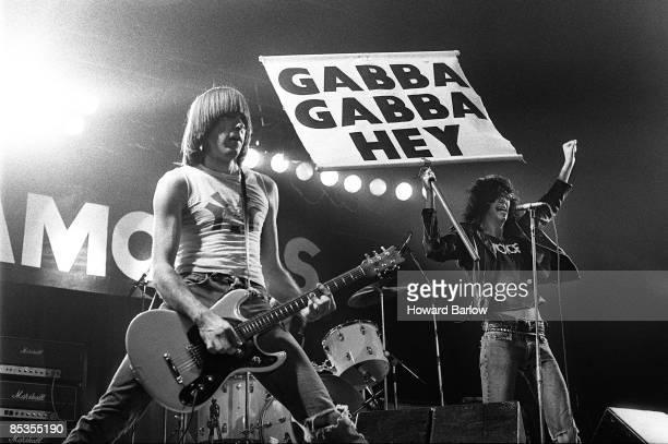 Photo of RAMONES and Johnny RAMONE and Joey RAMONE, Johnny and Joey Ramone performing on stage, sign