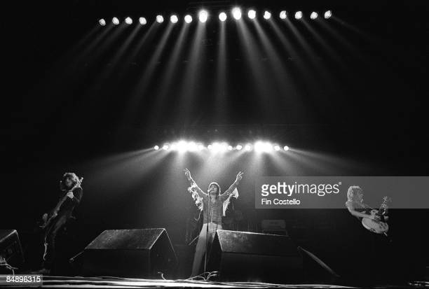 Photo of Randy RHOADS and Ozzy OSBOURNE LR Bob Daisley Ozzy Osbourne Randy Rhoads performing live onstage at Gaumont Theatre