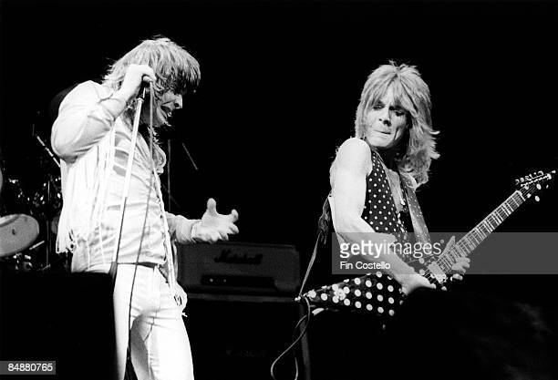 Photo of Randy RHOADS and Ozzy OSBOURNE with his guitarist Randy Rhoads performing live onstage at Gaumont Theatre