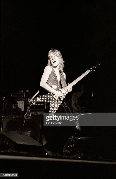 Photo of Randy RHOADS performing live onstage with Ozzy Osbourne's band playing Jackson guitar