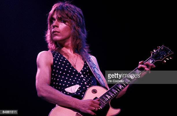 Photo of Randy RHOADS; playing Gibson Les Paul guitar, performing live onstage with Ozzy Osbourne