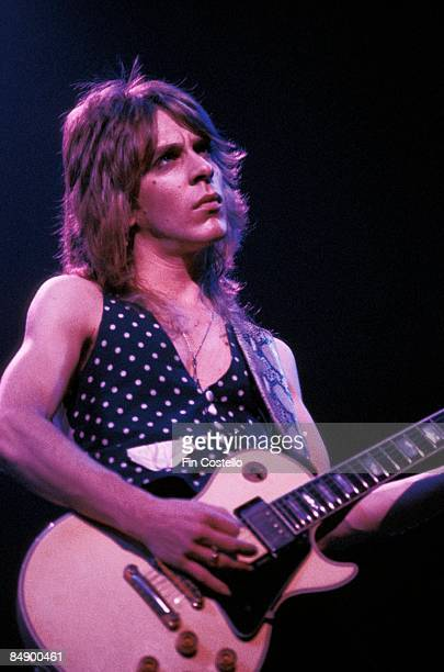 Photo of Randy RHOADS playing Gibson Les Paul guitar performing live onstage with Ozzy Osbourne