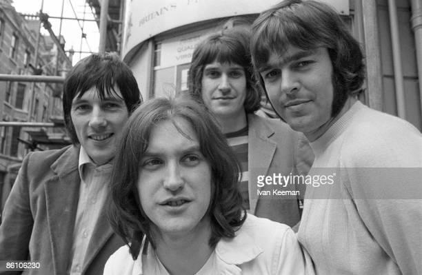 Photo of Ray DAVIES and Mick AVORY and KINKS and John DALTON and Dave DAVIES LR Mick Avory Dave Davies Ray Davies John Dalton posed group shot