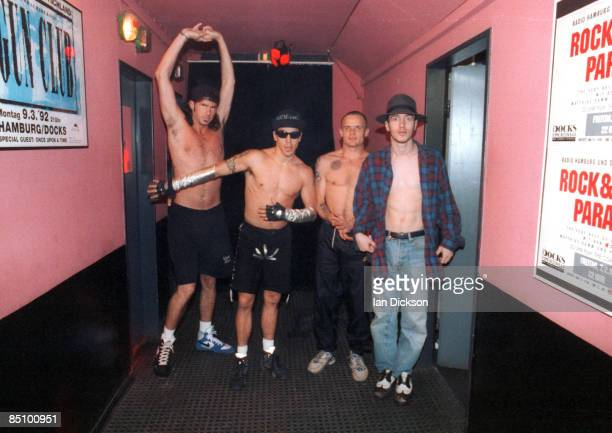 Photo of RED HOT CHILI PEPPERS and Anthony KIEDIS and FLEA and John FRUSCIANTE and Chad SMITH; Group portrait backstage L-R Chad Smith, Anthony...
