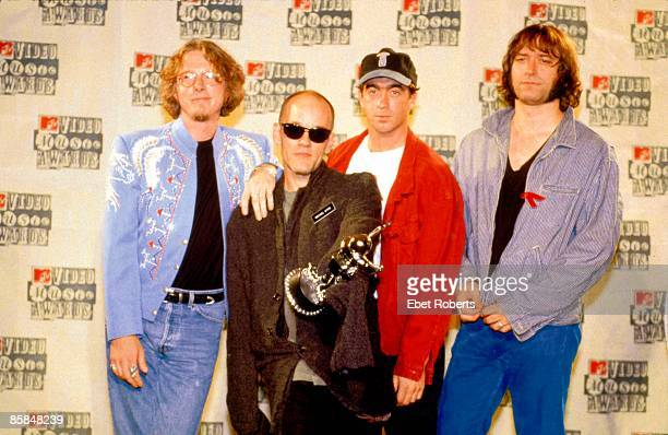 HALL Photo of REM and Michael STIPE and Mike MILLS and Peter BUCK and Bill BERRY LR Mike Mills Michael Stipe Bill Berry Peter Buck posed group shot...