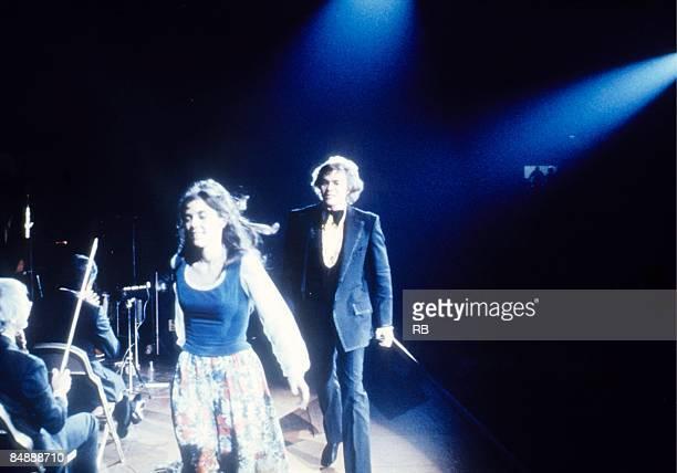 Photo of Richard CARPENTER and Karen CARPENTER and CARPENTERS Karen and Richard Carpenter leaving the stage