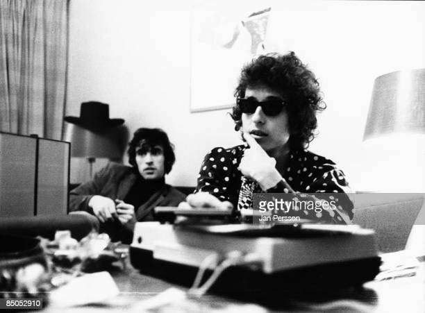 Photo of Richard MANUEL and Bob DYLAN with Richard Manuel doing interview