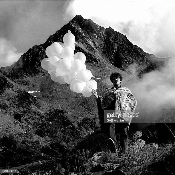 Photo of Richard SWIFT posed holding balloons standing on mountain