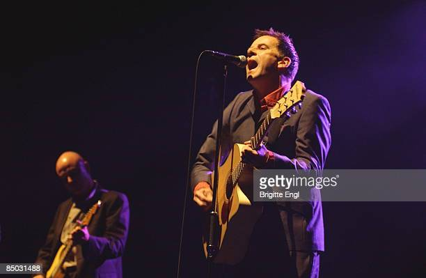 APOLLO Photo of Ricky ROSS and DEACON BLUE Ricky Ross playing guitar live on stage in background
