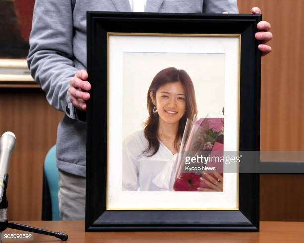 A photo of Rie Miyoshi who was killed by her stalker exboyfriend in Zushi Japan in 2012 is shown by her husband during a press conference in Yokohama...