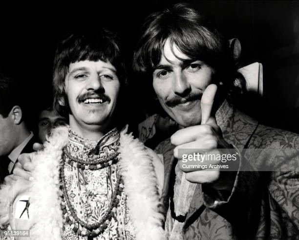 Photo of Ringo STARR and George HARRISON and BEATLES, L-R. Ringo Starr, George Harrison posed, doing thumbs up, at the 'All You Need Is Love' session