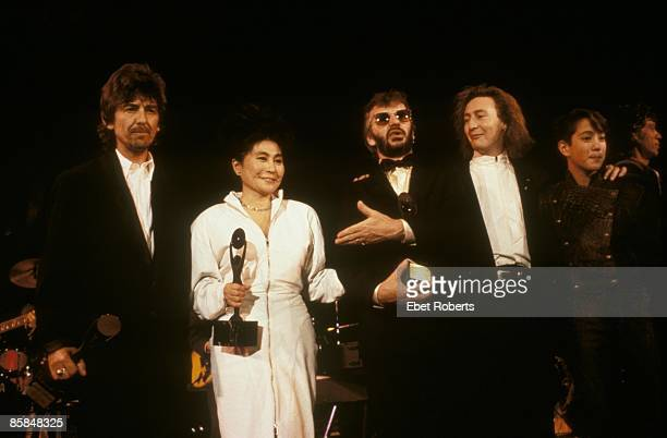 Photo of Ringo STARR and George HARRISON and Yoko ONO and BEATLES; L-R: George Harrison, Yoko Ono, Ringo Starr, Julian & Sean Lennon at the Beatles'...