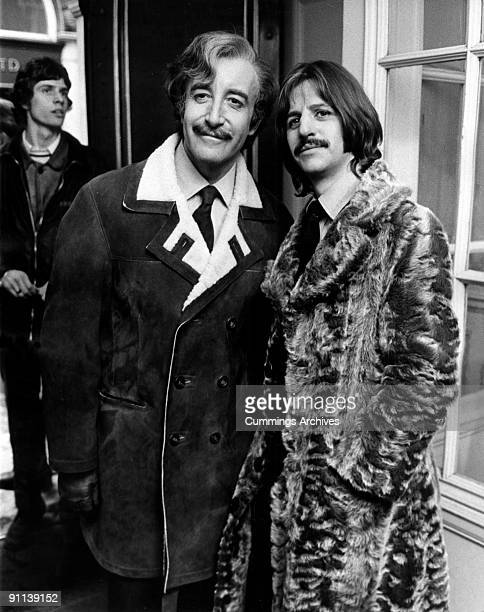 Photo of Ringo STARR and Peter SELLERS posed with Peter Sellers during filming of 'The Magic Christian'