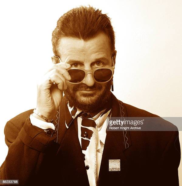 Photo of Ringo STARR; posed, studio, in the early 1990's, looking over sunglasses