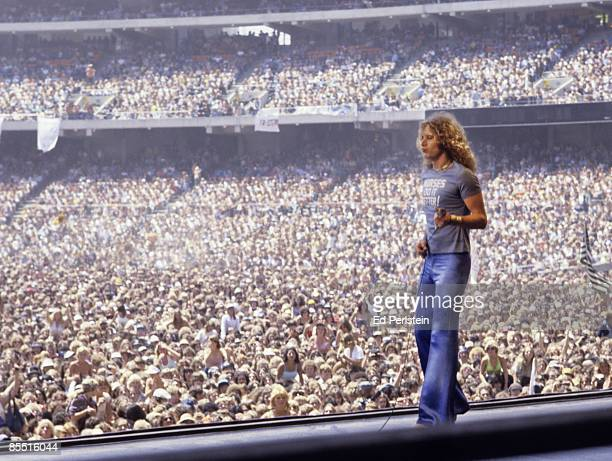 COLISEUM Photo of Robert PLANT and LED ZEPPELIN Robert Plant performing on stage wearing 'Nurses do it Better' t shirt audience in photo