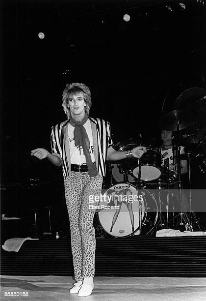 Photo of Rod STEWART, performing live onstage, full length, wearing leopard print trousers