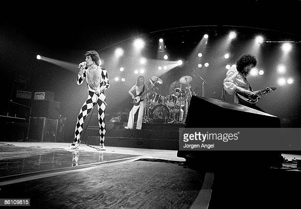 Photo of Roger TAYLOR and QUEEN and Freddie MERCURY and John DEACON LR Freddie Mercury John Deacon Roger Taylor Brian May performing live on stage at...