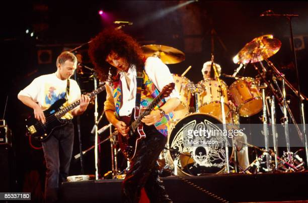STADIUM Photo of Roger TAYLOR and QUEEN and John DEACON and Brian MAY LR John Deacon Brian May and Roger Taylor performing on stage at the Freddie...