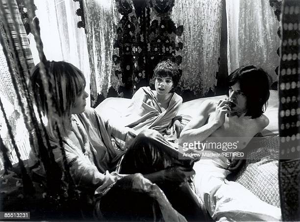 Photo of ROLLING STONES and Anita PALLENBERG and Mick JAGGER of the Rolling Stones on the set of Performance with Anita Pallenberg