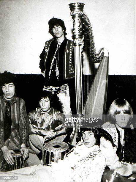 Photo of ROLLING STONES and Charlie WATTS and Mick JAGGER and Keith RICHARDS and Bill WYMAN and Brian JONES Posed group portrait LR Bill Wyman...