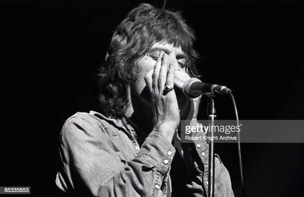 Photo of ROLLING STONES and Mick JAGGER Mick Jagger performing on stage playing harmonica