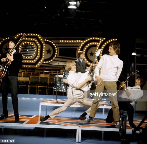 Bill Wyman Brian Jones Charlie Watts Mick Jagger Keith Richards performing on TV Show