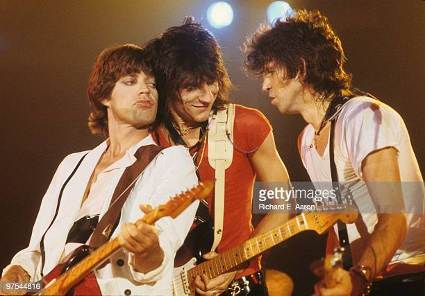 Photo of ROLLING STONES; L-R: Mick Jagger, Ron Wood and Keith Richards performing live onstage at the Oshawa Civic Auditorium, playing a benefit...