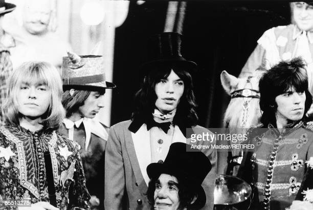 Photo of ROLLING STONES on the set of 'Rock 'n' Roll Circus' LR Brian Jones Mick Jagger Keith Richards