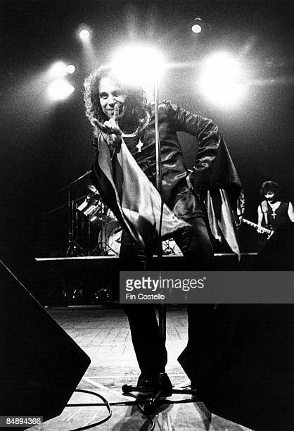Photo of Ronnie DIO and BLACK SABBATH Ronnie Dio performing live onstage at Gaumont doing manu cornuta to camera