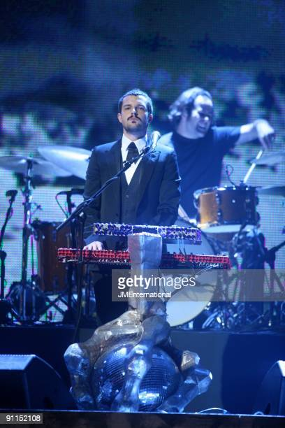 AWARDS Photo of Ronnie VANNUCCI and Brandon FLOWERS and KILLERS LR Brandon Flowers Ronnie Vanucci performing at 2007 Brit Awards at Earls Court