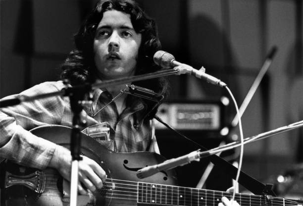 Photos en vrac - Page 13 Photo-of-rory-gallagher-rory-gallagher-performing-live-on-stage-picture-id84897106?b=1&k=6&m=84897106&s=612x612&w=0&h=ckGJHW75KC70pr1aSvAz5ZvYvCbXgtx3tBKwYISW2A4=
