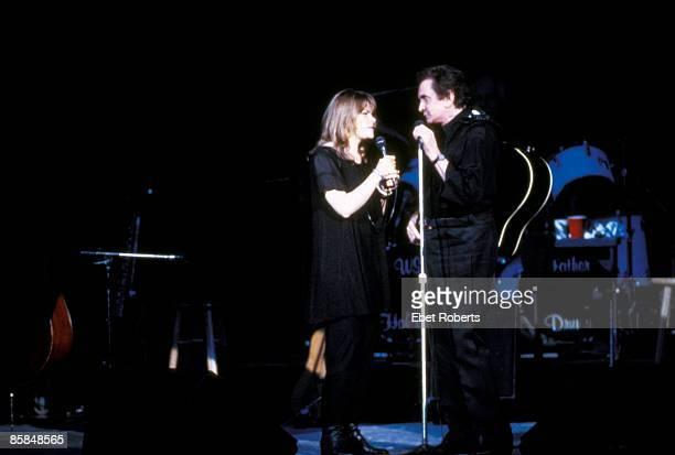 Photo of Rosanne CASH and Johnny CASH Johnny Cash with daughter Rosanne Cash performing on stage