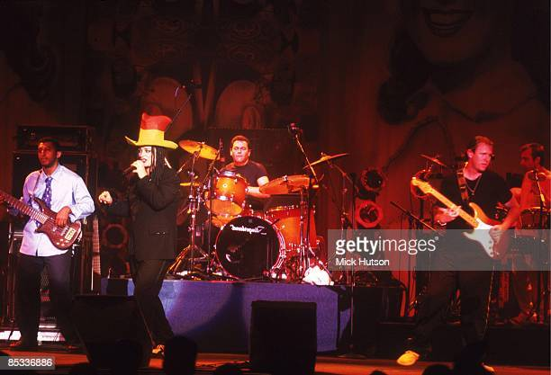 Photo of Roy HAY and Jon MOSS and BOY GEORGE and Mikey CRAIG and CULTURE CLUB Group performing on stage LR Mikey Craig Boy George Jon Moss and Roy Hay