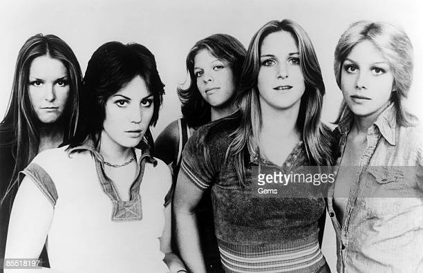 Photo of RUNAWAYS and Lita FORD and Joan JETT and Jackie FOX and Sandy WEST and Cherie CURRIE Posed group portrait LR Lita Ford Joan Jett Jackie Fox...
