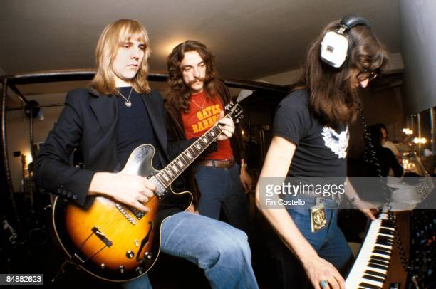 Photo of RUSH LR Alex Lifeson Neil Peart Geddy Lee