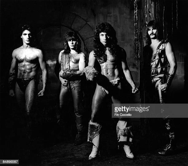 Photo of Scott COLUMBUS and Eric ADAMS and MANOWAR and Ross FRIEDMAN and Joey DeMAIO Posed studio group portrait full length barechested LR Joey...
