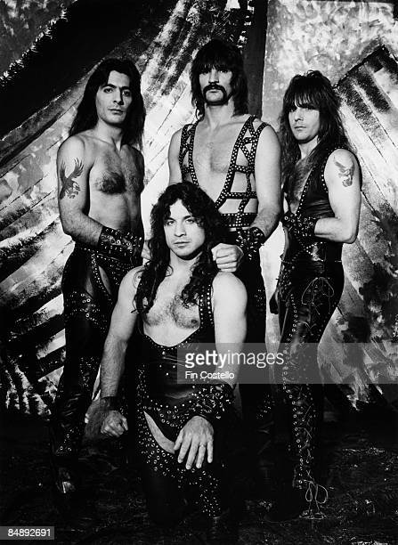 Photo of Scott COLUMBUS and Joey DeMAIO and Ross FRIEDMAN and Eric ADAMS and MANOWAR Posed studio group portrait LR Joey DeMaio Eric Adams Scott...